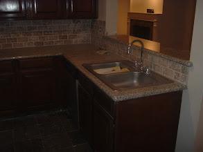 Photo: counter top marble W/ brick design Turkish tiles.