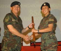 1WO Tan receiving her pacestick from 1WO Chin, outgoing RSM of 46 SAR. (PHOTO: Lum Ngia)