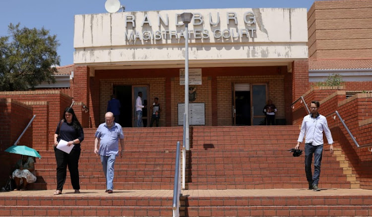 People leave the Randburg magistartes court after the appearance of Anna Britta Troelsgaard Nielsen, a former employee of the Danish National Board of Social Services (Socialstryelsen), in Randburg, South Africa November 5, 2018.