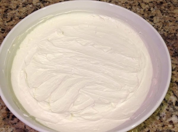 Spread cream cheese to cover bottom of pie plate or shallow 8x8 dish.