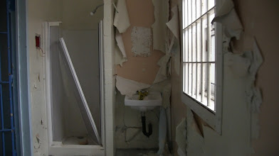 Photo: No private baths.  Just a common shower and sink for the row of inmates.