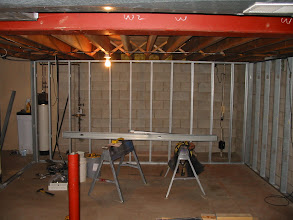 Photo: Front screen wall. Notice steel support post has been cut so it can be removed. Additional supports added where needed.
