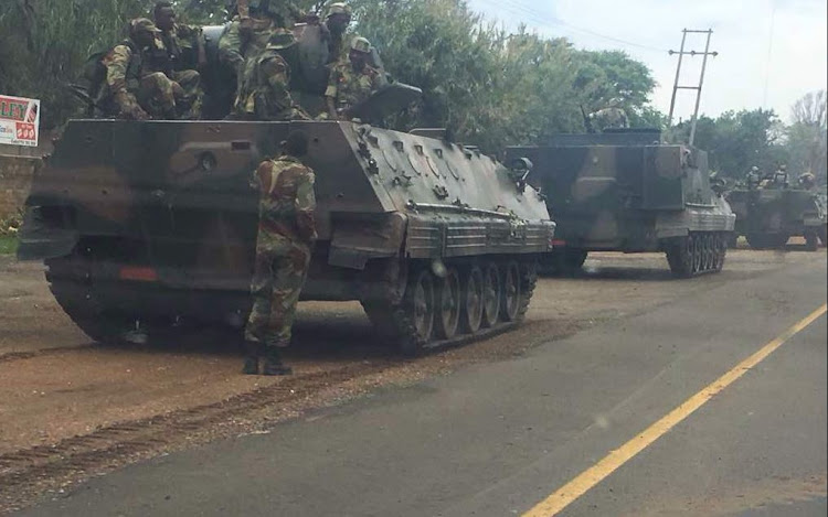 Armoured military vehicles seen heading towards the Zimbabwean capital of Harare; situation unclear on 14 November 2017/