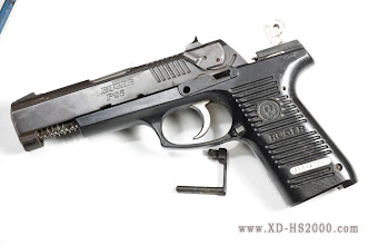 Photo: First make sure the pistol is unloaded! Then field strip the weapon.