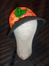 Photo: <KAPELUXE> Unique-Chique Hats by Luba Bilash ART & ADORNMENT  Midnight black wool felt cloche, hand-crocheted multicoloured ribbon, satin rosettes, wool felt leaves, 360 degree possibilities. Can also be worn on an angle Size L - 56 cm/22 in. $85 SOLD