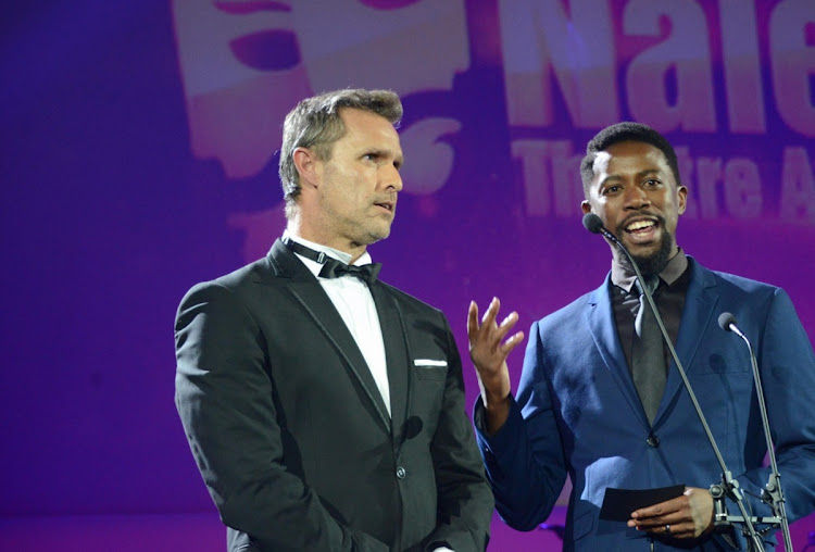 Craig Urbani, left, and actor Atandwa Kani share the stage during the Naledi Awards at Gold Reef City in Johannesburg in this April 19 2016 file photo. Urbani, who will play the role of Billy Flynn in the hit musical Chicago, maintains a fierce workout schedule. Picture: GALLO IMAGES/FRENNIE SHIVAMBU