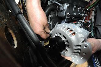 Photo: Fitting Alternator. Oyster 406 Yanmar 4JH5E Large Alternator