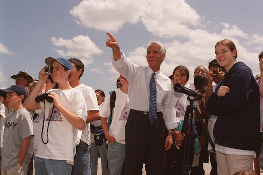 Students enjoy the launch of Space Shuttle Endeavour on mission STS-100 in the company of the State Education Commissioner Charlie Crist center.