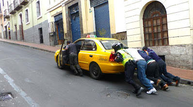 Photo: Pushing a stalled cab up the street