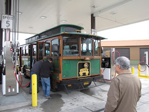 Photo: Phoenix City Manager Eli Naffah watched the fueling demonstration for the Crater Lake Trolley.