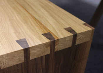 Close up detail of dovetailed bench joint in Oak & Walnut