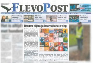 Photo: At Dronten the local newspaper is announcing the exhibition.