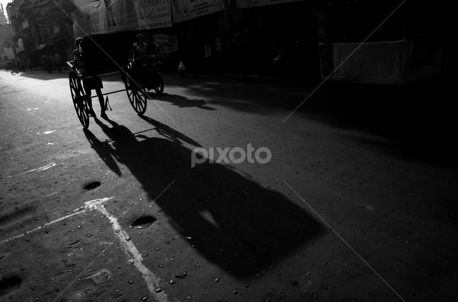 The Shadow by Sandip Ghose - City,  Street & Park  Street Scenes ( rikshaw, shasdow, b&w, kolkata, street )