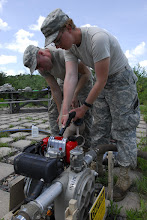 Photo: Wisconsin National Guard Soldiers from the 257 Brigade Support Battalion performed their 2-week annual training at Camp Ripley, Minn. this month. Water Treatment Specialists of Alpha Company spent a few days at Lake Ferrell testing the water, their skills and their equipment. Spc. Daniel Clark and Spc. Adeline Barnes fuel the water pump.  Photo by Sgt. 1st Class Daniel Ewer http://www.minnesotanationalguard.org/press_room/e-zine/articles/index.php?item=3429