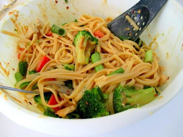 Now, in a bowl, toss together the chicken, linguine, veggies and sauce. Toss until...