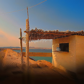 village by Fereshteh Molavi - Buildings & Architecture Other Exteriors ( cottage, boats, cloud, sea, shadows )