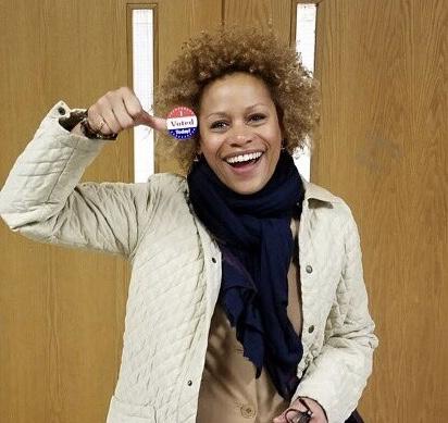 "Dr. Vida Samuel proudly shows off her ""I Voted"" sticker."