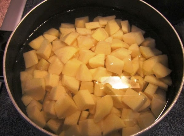 Boil the potatoes until tender, drain, and mash with the butter, cream, and salt/pepper...