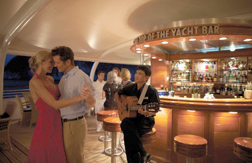 Seadream-dancing-guitar.jpg - Take to the dance floor for a memorable evening on SeaDream Yacht Club.