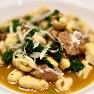Ricotta Cavatelli with Slow-Roasted Pork, Broccoli Rabe, and Pine Nuts.