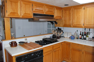 Photo: Before remodel - cooktop and hood.
