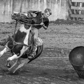 Oops! by Joe Saladino - Black & White Sports ( horse, barrel race, competition, rider, boy )