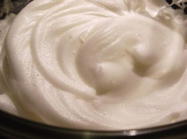 Finally whip, egg whites till stiff add in whipped cream and fold into mixture.