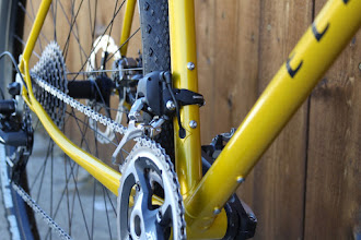 Photo: The internal Di2 wiring exits just below the front derailleur.  Because I bent the drive side chainstay, I can run this 44 x 30T XTR crank without the front derailleur's cage hitting the chainstay.  You can also spot the K-Edge modified rear Di2 derailleur, the long cage will allow me to run a 36T max rear cog, although it's set up with a 34T for now.