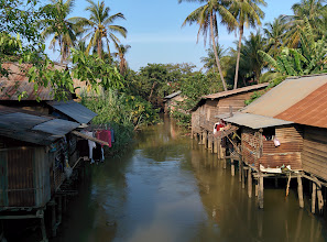 Photo: In stark contrast to Thailand, Cambodia is one of the poorest countries in Asia. Many people still live in houses without electricity or modern sanitation.