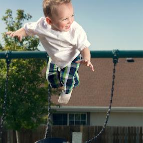 Swinging High by Braxton Wilhelmsen - News & Events World Events ( playground, kids' fashion, advertising, baby, swing, photography )
