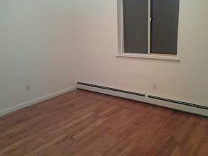 Photo: New Hardwood Floors and Baseboard heat covers in Long Beach, NY after Sandy