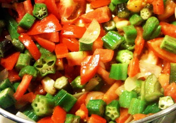 Add tomatoes, okra and V-8, bay leaf, basil and parsley. Simmer on low, covered,...