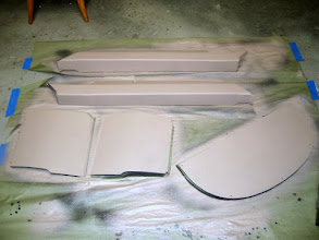 Photo: Rear armrests, pilot and copilot seat bottoms, and rear cover panel all painted with Zolatone Desert Camo
