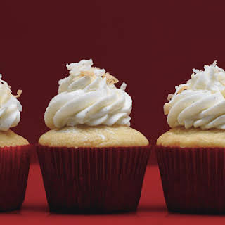 Vanilla Bean-Coconut Cupcakes with Frosting.
