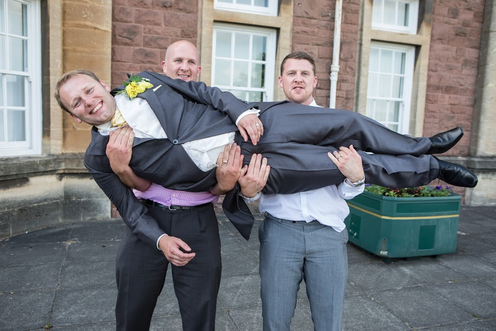groom-lifted-up