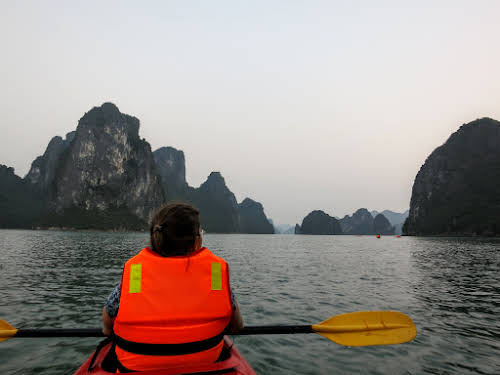 Patricia enjoying the view of Halong Bay while kayaking