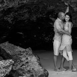 Kissing under the rocks by Andrew Morgan - Wedding Other ( holiday, love, honeymoon, zanzibar, kiising )