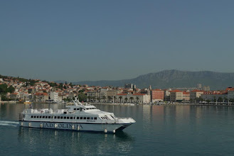 Photo: Ferry servicing nearby islands with city of Split in background