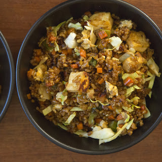 Sweet-and-Spicy Indonesian-Style Fried Rice With Tofu, Eggs and Vegetables.