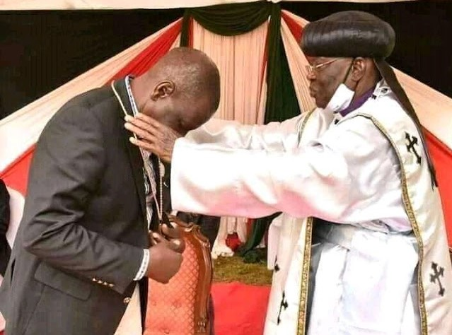 Deputy President William Ruto with Father John Pesa at Sugoi.