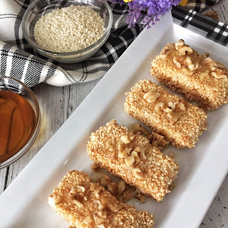 Sesame Coated Fried Feta With Honey And Walnuts.