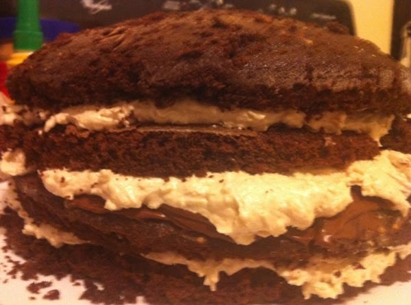 Add the remaining coconut filling to this layer and top with the last cake...