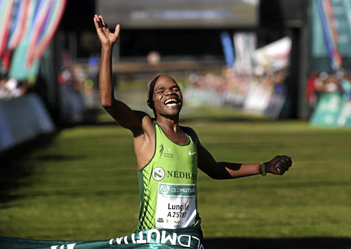 Victory: Lungile Gongqa as he wins the Two Oceans in Cape Town. Picture: SUNDAY TIMES