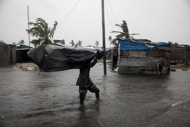 Residents of the Praia Nova neighbourhood seek shelter from tropical cyclone Eloise in Beira, Mozambique, on January 23.