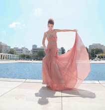 Photo: SEE the video of the photoshoot: http://youtu.be/d8B-RVDwAaQ TEL AVIV - Daniel Romi Kadosh is a talented designer celebrating more than 12 years of haute couture design. His 2013 Bridal Couture collection features model Monika Hederova. She wears crystal earrings and a backless dress with a train and lots of fabric. Other gowns are embellished with beadings and cut in sculpted precision. Floral, lace, architectural, and beaded trends can all be seen here. Appearance: Monika Hederova