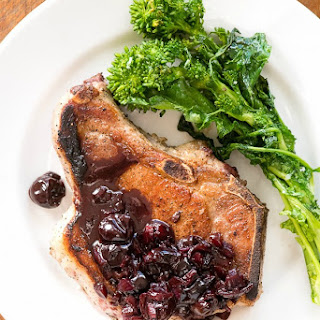 Pan-fried Brined Pork Loin Chops with Cherry Sauce.