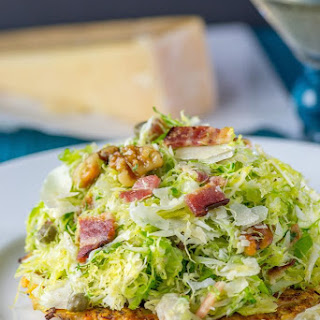 Shaved Brussels Sprouts Over Crispy Cauliflower Cakes.