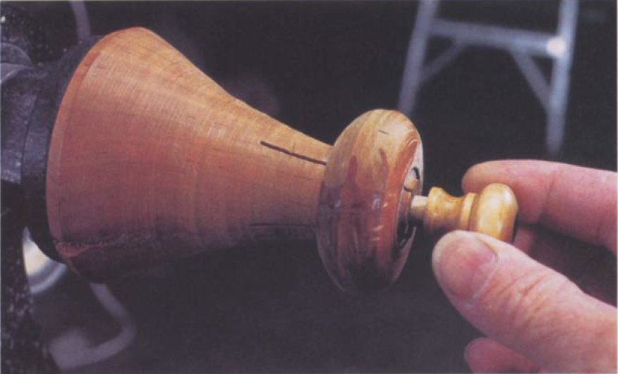 This homemade chuck is no more than a shop-built collet chuck. The outside of the chuck is turned to a gentle taper, and the tip is partially split by bandsawing or backsawing. A ring of suitable diameter is then added. By forcing the ring down over the taper, the chuck is closed.