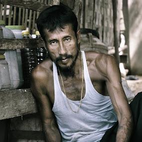 Burmese fish butcher by Tanawat Pontchour - People Portraits of Men