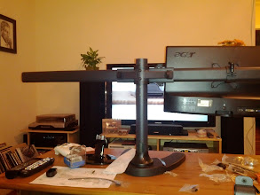 Photo: Mounting the first monitor.